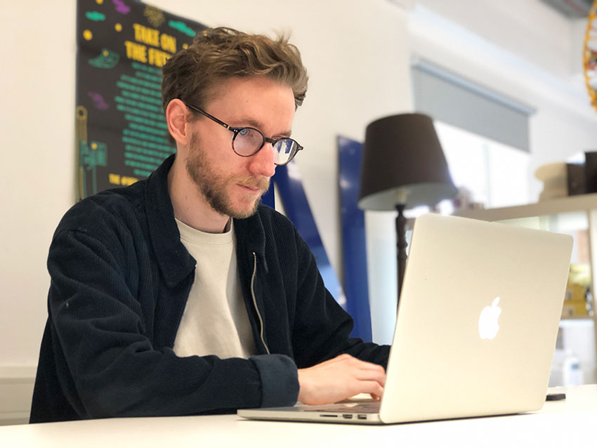 Tom working