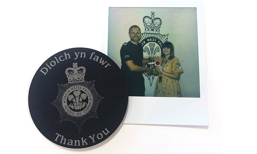 Lauren Harwood with the Chief of Police and a thank you coaster