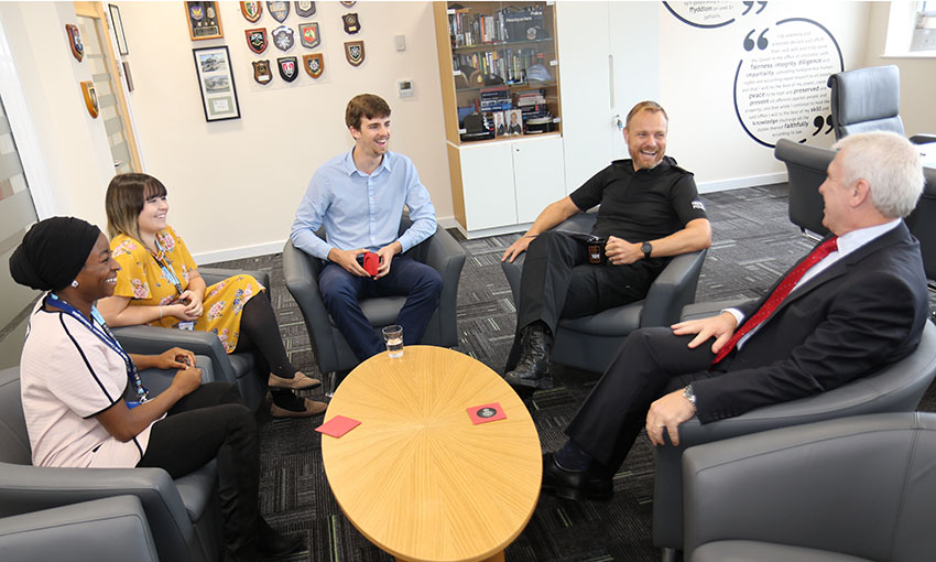 Lauren in a thank you meeting with the Chief Constable of South Wales Police and two other interns