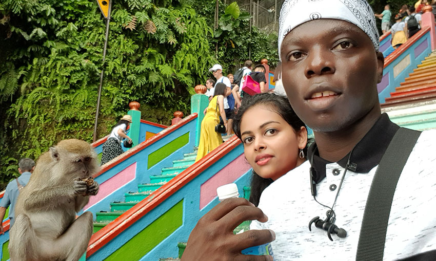 Moses visiting the Batu caves with a friend and a monkey