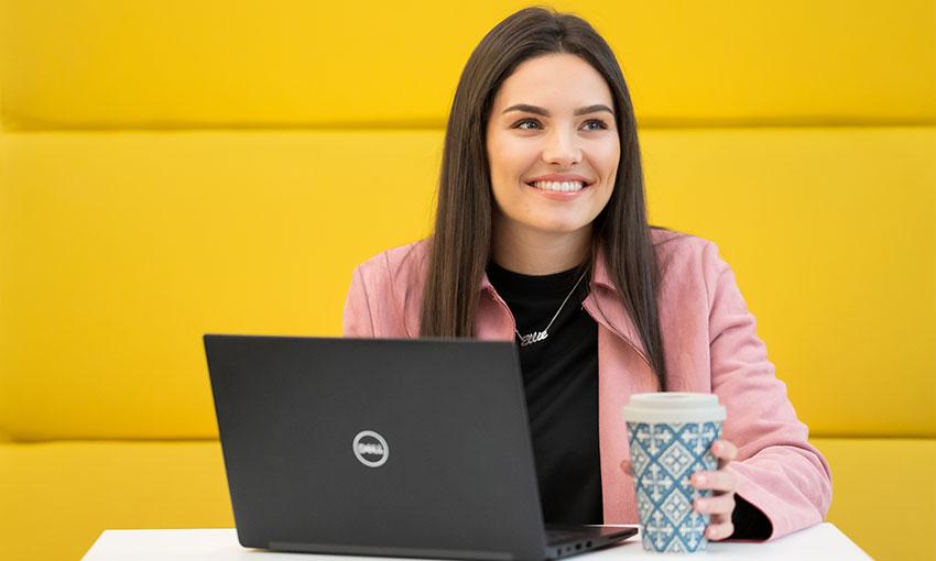 Ellie Herbert at a Desk