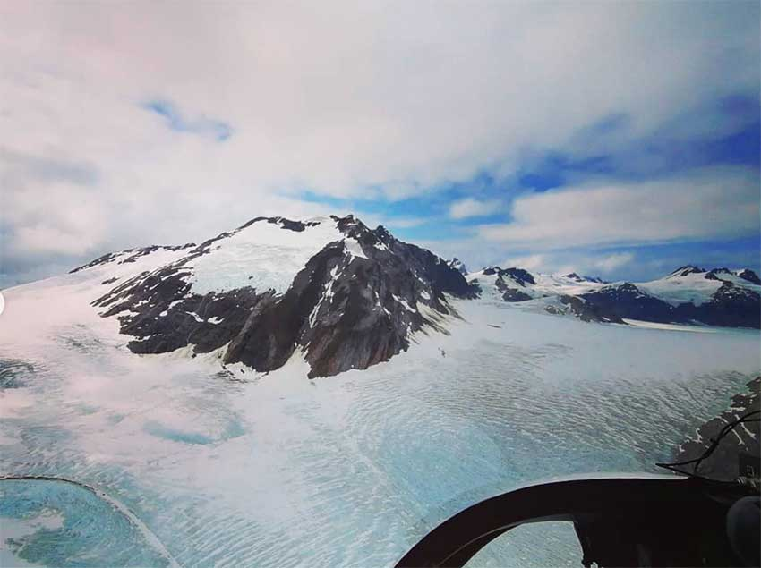 View from a helicopter of snowy mountains