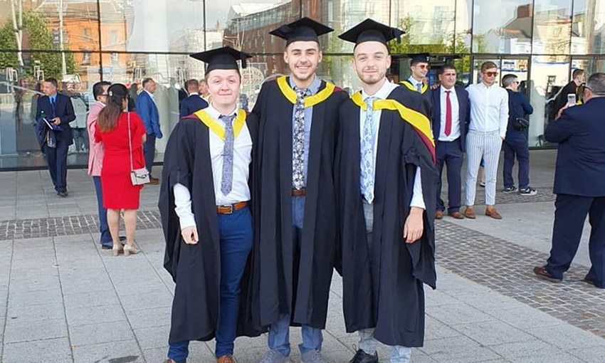 Ben Hayes with friends, all in cap and gown