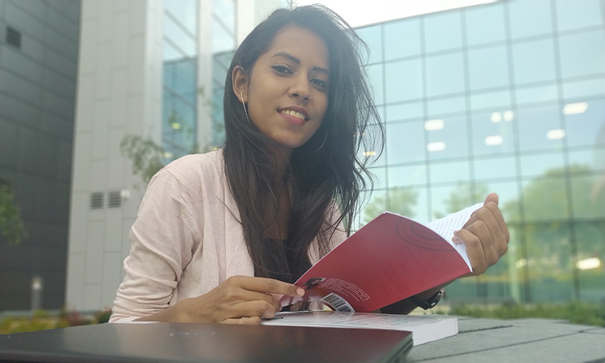 Harshita sitting with a book