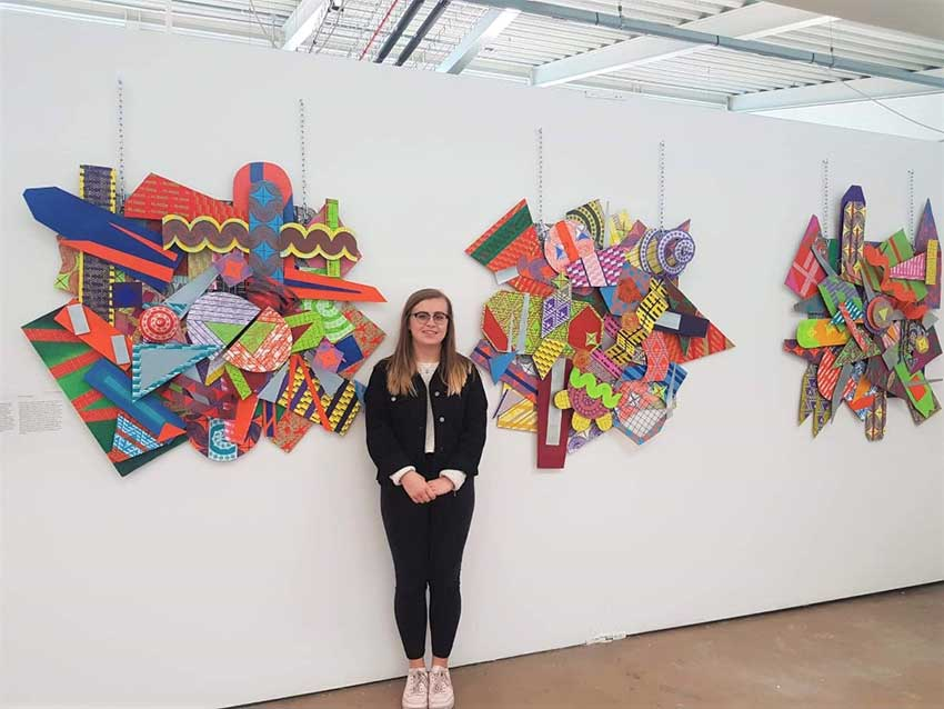 Lauren at the summer degree show with her art