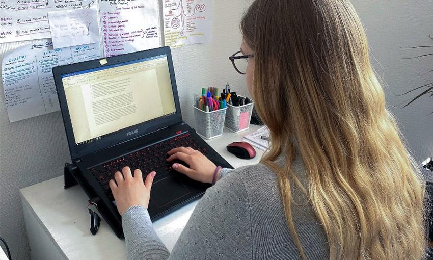 Nika at her laptop