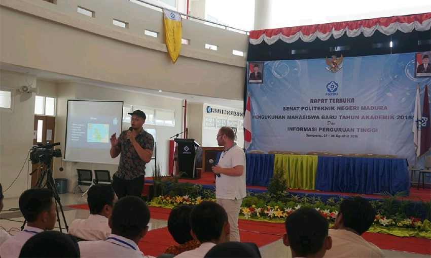 Liam Brooks speaking in front of Malaysian students