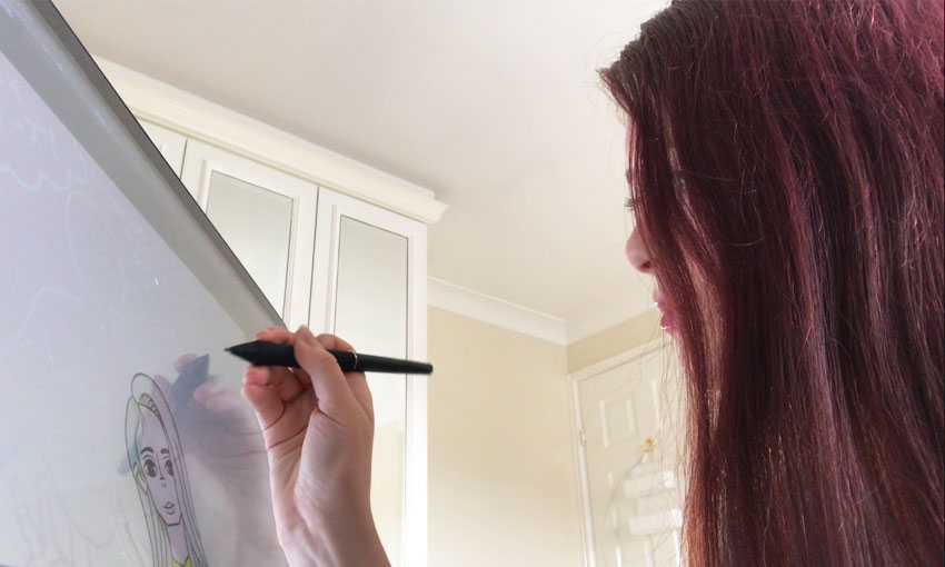 Erin O'Keefe drawing on a tablet